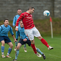 Newmarkets Eoin Hayes heads the ball towards the goal