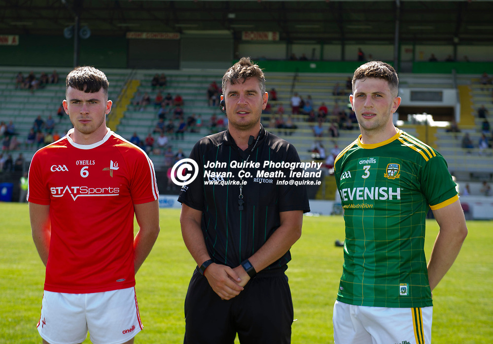 24-07-21. Meath v Louth - Leinster MFC Semi-Final at Pairc Tailteann, Navan.<br /> Louth captain Cameron Maher and Meath captain Liam Kelly with referee<br /> Photo: John Quirke / www.quirke.ie<br /> ©John Quirke Photography, 16 Proudstown Road, Navan. Co. Meath. (info@quirke.ie / 046-9028461 / 087-2579454).