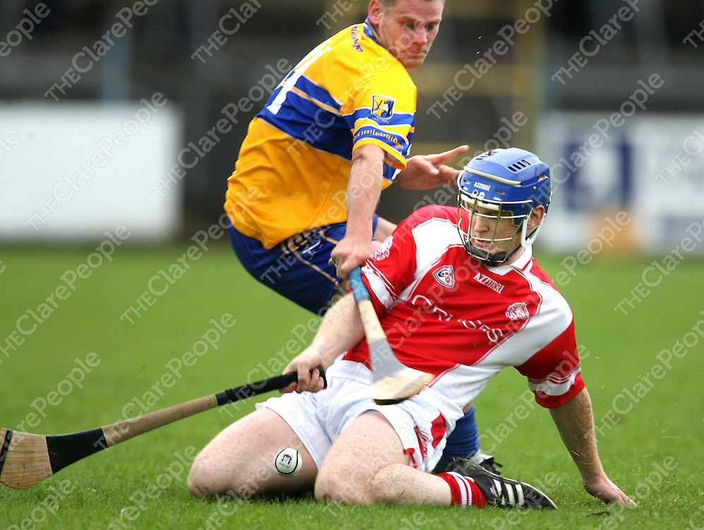 John Reddan and Adrian Flaherty in action during the Eire Og V Sixmilebridge senior Hurling championship match at Cusack park on Saturday evening.<br /><br />Photograph by Eamon Ward