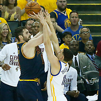 01 June 2017: Cleveland Cavaliers forward Kevin Love (0) takes a jump shot over Golden State Warriors guard Klay Thompson (11) during the Golden State Warriors 113-90 victory over the Cleveland Cavaliers, in game 1 of the 2017 NBA Finals, at the Oracle Arena, Oakland, California, USA.