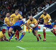 Horatiu Pungea (Romania) trying to break through the French defense during the Rugby World Cup Pool D match between France and Romania at the Queen Elizabeth II Olympic Park, London, United Kingdom on 23 September 2015. Photo by Matthew Redman.