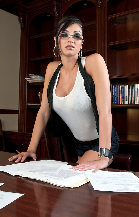 Beautiful and very sexy secretary working after hours.