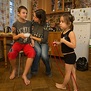 """CAPTION: While Ksenya is highly devoted to her children, her son Dmitry's extreme autism takes a considerable amount of her daily energy. """"Without the Short Break Service, my life would be much sadder"""", she says, speaking of Partnership For Every Child (P4EC)'s assistance. Tatiana and Marina are the two carers who visit regularly, and Marina in particular is excellent at stimulating Dmitry. They always come to the apartment, as Dmitry would become too anxious if they took him out. LOCATION: St Petersburg, Russia. INDIVIDUAL(S) PHOTOGRAPHED: Ksenya Shpunt (mother), Dmitry Shpunt (son) and Yana Shpunt (daughter)."""