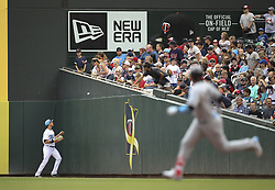June 18, 2017 - Minneapolis, MN, USA - Minnesota Twins right fielder Max Kepler waits for the ball hit by Cleveland Indians third baseman Jose Ramirez, foreground, to finish bouncing atop the padding on the wall before he can make a play in the first inning on Sunday, June 18, 2017 at Target Field in Minneapolis, Minn. Ramirez made it safely to second. (Credit Image: © Jeff Wheeler/TNS via ZUMA Wire)