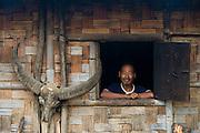 Konyak Naga house & buffalo skulls<br /> Konyak Naga headhunting Tribe<br /> Mon district<br /> Nagaland,  ne India