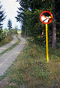 Country road sign about dipping headlights, Finland, 1973