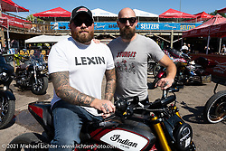 Rich Christoph (R), Lead Industrial Designer at Indian Motorcycle with Seth Bowman on his custom FTR in the Dennis Kirk Garage Build bike show at the Iron Horse Saloon during the Sturgis Motorcycle Rally. Seth runs the FTR1200owners and Chiefowners social media pages. SD, USA. Tuesday, August 10, 2021. Photography ©2021 Michael Lichter.