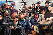 Boys from Afghanistan sing songs after a number of british volunteers came to help by setting up a night of music and singing.