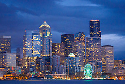United States, Washington, Seattle. The downtown skyline at dusk, seen from Elliott Bay looking east.