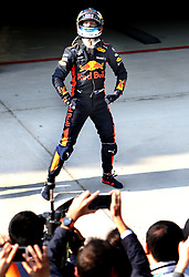 SHANGHAI, April 15, 2018  Red Bull's driver Daniel Ricciardo of Australia celebrates after winning the Formula One Chinese Grand Prix in Shanghai, east China, April 15, 2018. Daniel Ricciardo claimed the title of the event in 1 hour, 35 minutes and 36.380 seconds.  dx) (Credit Image: © Fan Jun/Xinhua via ZUMA Wire)