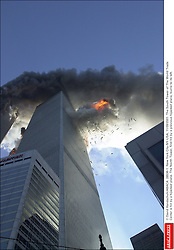 © David Handschuh/ABACA. 28536-1. New York City-NY-USA, 11/09/2001. The South Tower of The World Trade Center is hit by a hijacked plane. The North Tower, first hit by a previous hijacked plane, burns to its left.  | 28536_01