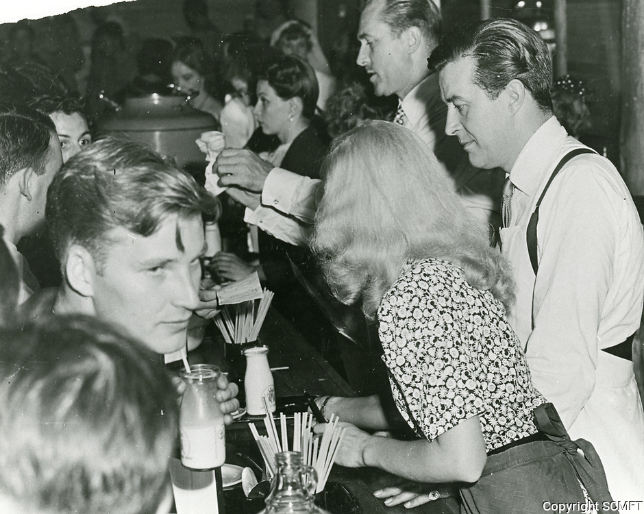1943 Brian Ahern and Ray Milland serve food and drinks at the Hollywood Canteen's snack bar.