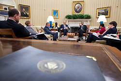 President Barack Obama and Vice President Joe Biden receive the Presidential Daily Briefing in the Oval Office, Oct. 22, 2014. Seated with them from left, are: Ben Rhodes, Deputy National Security Advisor for Strategic Communications; Lisa Monaco, Assistant to the President for Homeland Security and Counterterrorism; Michael Dempsey, Deputy Director of National Intelligence for Intelligence Integration; National Security Advisor Susan E. Rice; and Tony Blinken, Deputy National Security Advisor. (Official White House Photo by Pete Souza)<br /> <br /> This official White House photograph is being made available only for publication by news organizations and/or for personal use printing by the subject(s) of the photograph. The photograph may not be manipulated in any way and may not be used in commercial or political materials, advertisements, emails, products, promotions that in any way suggests approval or endorsement of the President, the First Family, or the White House.
