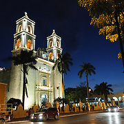 The front twin steeples of the Spanish colonial Cathedral of San Gervasio (Catedral De San Gervasio) at dusk. The Cathedral is next the main square in downtown Valladolid, in the heart of Mexico's Yucatan Peninsula.
