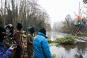 Dan Hooper, better known as roads protester Swampy during the 1990s, occupies a tripod positioned in the river Colne in order to try to delay bridge building works in connection with the HS2 high-speed rail link on 7 December 2020 in Denham, United Kingdom. Anti-HS2 activists continue to resist the controversial £106bn rail project from a series of protest camps based along its initial route between London and Birmingham.