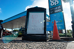 © Licensed to London News Pictures 29/09/2021.<br /> Swanley, UK, Unleaded only sign. This man is celebrating football style after getting to the front of the queue. The petrol shortage continues today with motorists queuing for hours at this Co-op petrol station in Swanley, Kent. This station only had unleaded left at two pumps at 10.30am, staff said the station will be empty within two hours. Photo credit:Grant Falvey/LNP
