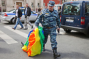 Moscow, Russia, 27/05/2012..A policeman carries a seized gay rights banner at an attempted gay pride parade in central Moscow. Several dozen people were arrested during clashes as Russian nationalists attacked gay rights activists during their seventh attempt to hold a gay pride parade in the Russian capital.