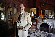 """Jude Pfister, chief of cultural resources at Morristown National Historical Park has written a new book: """"Morris County's Acorn Hall."""" He stands in the library of the home. The estate, which dates to the mid-19th century, is home to the Morris County Historical Society. Morristown, NJ. Sunday, July 19, 2015.<br /> Special to NJ Press Media/Karen Mancinelli/Daily Record<br /> MOR 0719 Acorn Hall"""