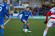 AFC Wimbledon midfielder Mitchell (Mitch) Pinnock (11) dribbling during the EFL Sky Bet League 1 match between AFC Wimbledon and Doncaster Rovers at the Cherry Red Records Stadium, Kingston, England on 14 December 2019.