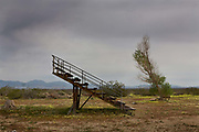 The bleachers in an empty playpark of Pearsonville, California, with a population of about 20, is a sad isolated place by highway 395 near the Sequoia National Park.