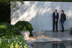 © Licensed to London News Pictures. 19/05/2014. London, England. Pictured: Fashion designer Sir Paul Smith at the Laurent-Perrier Garden with garden designer Luciano Giubbilei.  Press Day at the RHS Chelsea Flower Show. On Tuesday, 20 May 2014 the flower show will open its doors to the public.  Photo credit: Bettina Strenske/LNP