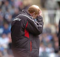 Photo. Leigh Quinnell.  Reading v Nottingham Forest Coca Cola championship. 16/04/2005. Nottingham Forest manager Gary Megson cant watch.