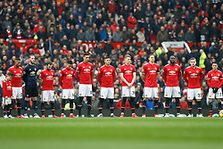Manchester United Players line up for a minutes silence in tribute to the Munich air disaster ahead of the Premier League match at Old Trafford, Manchester.