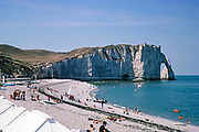 Chalk cliffs and sandy beach view to Falaise d'Aval, Etretat beach, Normandy, France 1976