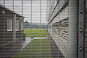 Looking through an internal fencing at an education building and a multi use games area (MUGA) inside HMP Featherstone, Wolverhampton, Staffordshire United Kingdom. HMP Featherstone is a Category C adult male training prison with a population of around 700 and operated by HM Prison Services. (Picture credit: © Andy Aitchison)