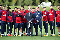 England manager Gareth Southgate (centre right) and Sir Bobby Charlton (centre left) pose for a picture with the England squad during a training session for the media day at St George's Park, Burton upon Trent.