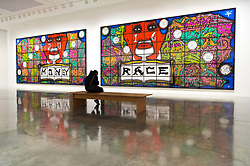 © Licensed to London News Pictures. 21/11/2017. London, UK. A visitor views artwork titled Sex Money Race Religion by artists GEORGE PASSMORE and GILBERT PROUSCH otherwise known as GILBERT and GEORGE. The work is showing at the exhibition The Beard Pictures and Their Fuckosophy at the White Cube gallery. Photo credit: Ray Tang/LNP