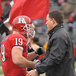 Dec 5, 2009; Piscataway, NJ, USA; Rutgers head coach Greg Schiano shakes hands with FB Jack Corcoran during the senior ceremony before first half NCAA Big East college football action between Rutgers and West Virginia at Rutgers Stadium.