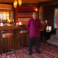 Africa, Morocco, Asni. Berber Tent Bartender at Richard Branson's Kasbah Tamadot luxury retreat in the Atlas Mountains.