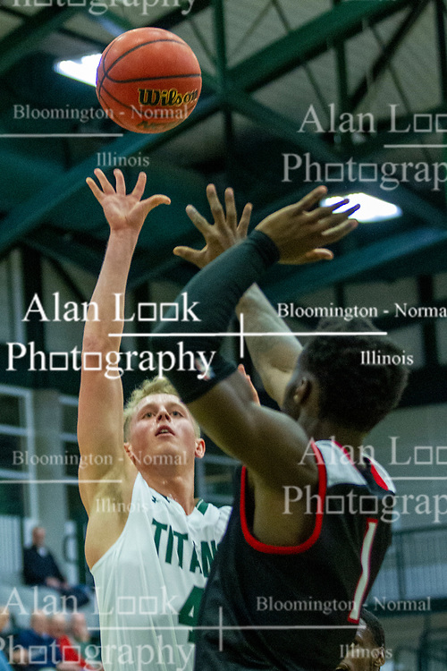 BLOOMINGTON, IL - November 12: Luke Yoder defended by Javon Stovall during a college basketball game between the IWU Titans  and the Blackburn Beavers on November 12 2019 at Shirk Center in Bloomington, IL. (Photo by Alan Look)