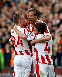 Stoke City's Peter Crouch (centre) celebrates scoring his side's second goal of the game