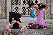 A family is enjoying a day at the Taj Mahal building, in Agra.