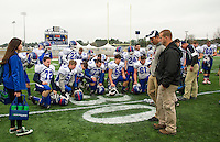 Interlakes Football gathers on the field following the 2015 NHIAA Division III state championship game with Newport on Sunday.   (Karen Bobotas/for the Laconia Daily Sun)