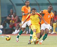 Photo: Steve Bond/Richard Lane Photography.<br />Ivory Coast v Benin. Africa Cup of Nations. 25/01/2008. Romuald Boco (C) is tackled by Didier Zakora (R)