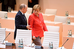 July 7, 2017 - Hamburg, Germany - Russian President Vladimir Putin walks with German Chancellor Angela Merkel during the first plenary session on the first day of G20 Summit meeting of world leaders July 7, 2017 in Hamburg, Germany. (Credit Image: © Marvin GüNgöR/Planet Pix via ZUMA Wire)