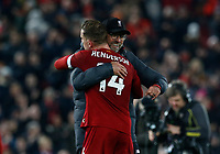 Football - 2019 / 2020 Premier League - Liverpool vs. Wolverhampton Wanderers<br /> <br /> Liverpool manager Jurgen Klopp celebrates with Jordan Henderson in front of the Kop after his side gains a 1-0 win, at Anfield.<br /> <br /> COLORSPORT/ALAN MARTIN