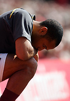 Thierry Henry of Arsenal collects his thoughts before coming on to score the equaliser.