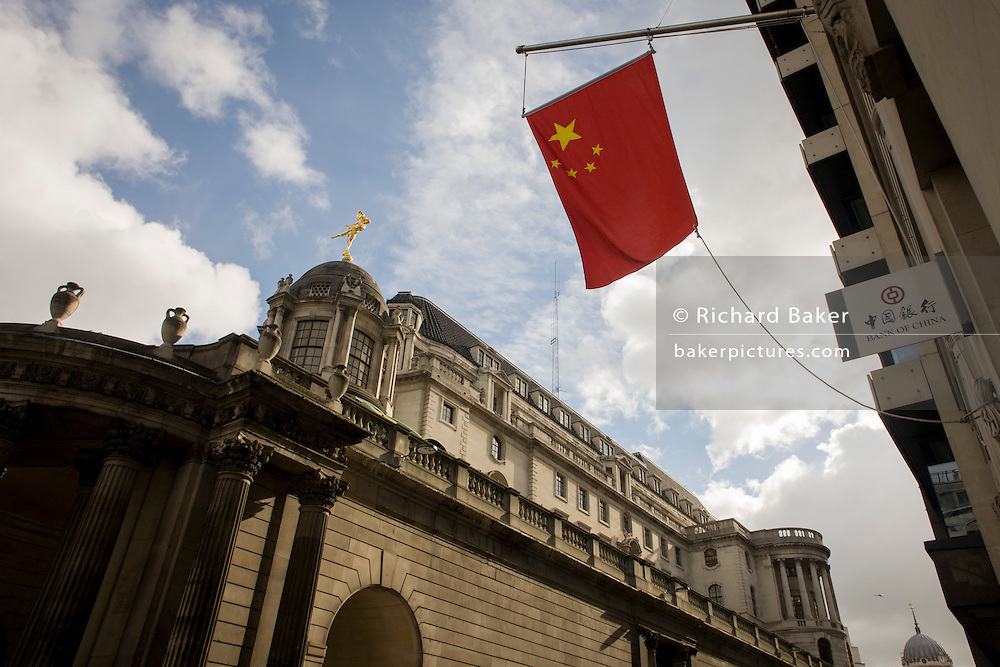 The Chinese national flag flies over the Bank of England in the City of London.