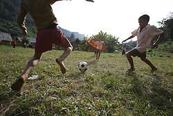 Plan International distributes sports kits which include skipping ropes, bats, and of course footballs which gets the boys and girls kicking and running. Teenpha village, Pha Oudom District, Bokeo Province, Lao PDR