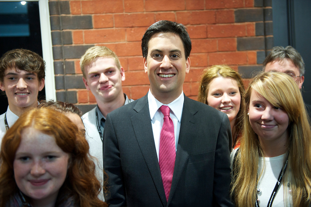 Newly elected Labour leader Ed Miliband greets students outside the auditorium at the Labour Party Conference in Manchester on 29 September 2010, the penultimate day of annual assembly.