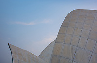 """NEW DELHI, INDIA - CIRCA OCTOBER 2016: Architectural detail of the The Lotus Temple in Delhi, also known as the  Bahai House of Worship. This is a popular tourist attraction in Delhi. The building is composed of 27 free-standing marble-clad """"petals"""" arranged in clusters of three to form nine sides, with nine doors opening."""