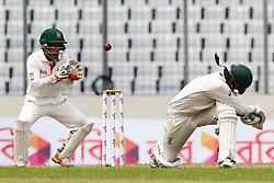 August 30, 2017 - Mirpur, Bangladesh - Nathan Lyon of Australia has his neck protector dislodged after a hit on the helmet from Shakib Al Hasan of Bangladesh during day four of the First Test match between Bangladesh and Australia at Shere Bangla National Stadium on August 30, 2017 in Mirpur, Bangladesh. (Credit Image: © Ahmed Salahuddin/NurPhoto via ZUMA Press)