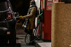 """A motorist fills up the gas tank of his vehicle at a service station in Bordeaux, France, on October 13, 2021. The price of diesel in France has reached its highest level, two years after the last peak in 2018 which sparked the """"yellow vests"""" protests. The average price at the pump reached 1.5354 euros last week, according to figures from the Ministry of Ecological Transition. The price of a liter of unleaded 95 was 1.60 euros, still below the 2012 record of 1.66 euros. Photo by Thibaud Moritz/ABACAPRESS.COM"""