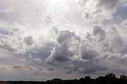 landscape and clouds with dramatic sunlight