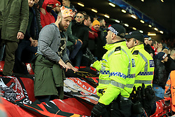 6th December 2017 - UEFA Champions League - Group E - Liverpool v Spartak Moscow - A CSKA fan wearing a pig mask speaks to the police officers - Photo: Simon Stacpoole / Offside.