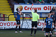 Referee Marc Edwards shows a red card to Ollie Rathbone of Rochdale during the EFL Sky Bet League 1 match between Rochdale and Burton Albion at the Crown Oil Arena, Rochdale, England on 27 February 2021.